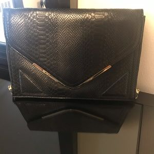 BCBGeneration black clutch with Zipper detail
